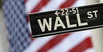 US stocks eke out small gains; Nasdaq sets record close