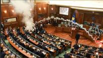 Opposition MPs in Kosovo throw tear gas in Parliament to stop voting on border agreement