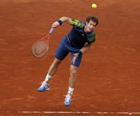 Murray digs deep to deal with dogged Mayer