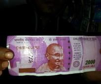 Bizzare! ATM dispenses Rs 2,000 notes with 'CHURAN LABEL' in place of Ashok emblem