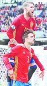 Pique earns Spain 3 points