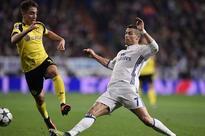 Dortmund strike late, beat Madrid to top spot