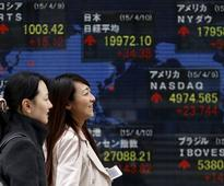 Asian stocks ride Wall Street rally, oil extends gains