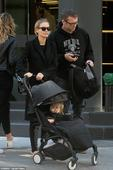 Lara Bingle and husband Sam Worthington are a coordinated couple in matching black outfits