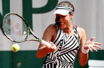 Bacsinszky reaches last 16 of French Open, Ivanovic out