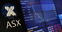 Australia shares at near 1-week low as banks slip; NZ shares steady