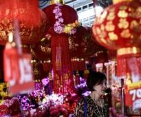 Chinese New Year 2016: What is the traditional meaning of giving red packets?