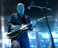 Pixies return as full band with heads in absurd