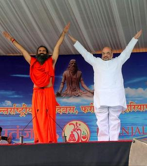 Amit Shah, Smriti, Rajnath roll out yoga mats