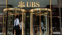 UBS puts salaries on ice as bank shares fall