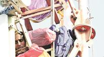 In poll-bound Punjab, protesters scale mobile towers to be heard