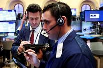 Wall St flat as investors parse earnings, data