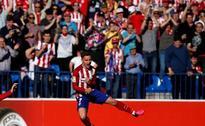 Atletico keep Barca under pressure