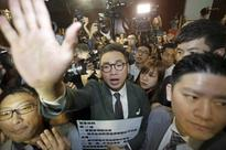 Chaos as Hong Kong pro-independence lawmakers barge into legislative chamber