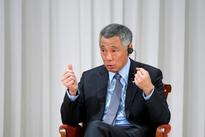 U.S. pull-out from Pacific trade deal hurts confidence, Singapore PM tells BBC