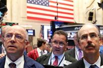 Wall Street falls as energy lags; shares post gains on week