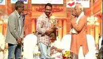 The new normal: Aamir Khan accepts award from RSS Chief Mohan Bhagwat