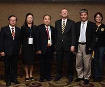 University of Iowa confers alumni award on local professor