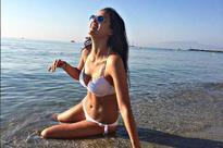 Former Bigg Boss contestant Natasa Stankovic sizzles in a white bikini