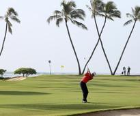UPDATE 1-Golf-Thomas moves five ahead at Waialae in record style