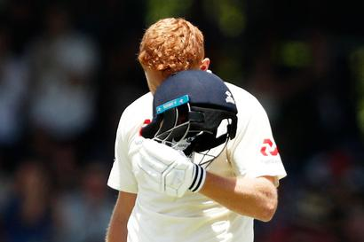 Bairstow celebrates Ashes ton with helmet head-butt