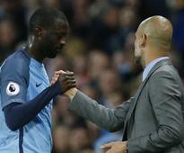 Premier League: Manchester City manager Pep Guardiola challenges Yaya Toure to win back place in squad