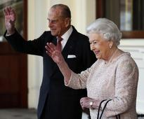 UK's Queen Elizabeth, 90 and husband Philip, 95, suffering heavy colds; delay travel