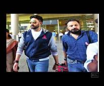 Abhishek Bachchan and Bunty Walia spotted outside the airport