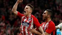 Gameiro penalty edges Atletico past Deportivo, closer to Barca in La Liga table