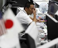 Asia stocks mixed, dollar slips as Fed continues to weigh