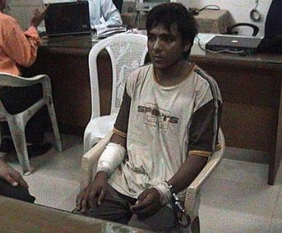 Shown pic of Kasab during deposition, Headley says, 'May God forgive you'