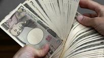 Tokyo stocks end up as exporters boosted by cheap yen