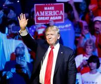 Facing new assault claims, Trump sees international plot