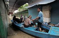 Monsoon floods kill 102 in India, strand pilgrims