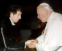 Poet and pope — or laureate and saint