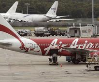 AirAsia flight returns safely to Perth after plummeting 20,000 feet