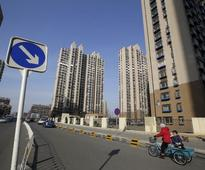 China home-buyers fret over prices, businesses more confident - c.bank surveys