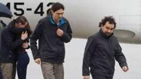 Kidnapped Spanish reporters return home