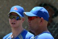 Struggling Aussies desperate to retain crown Australia's captain Steven Smith (L) gestures while talking with coach D...