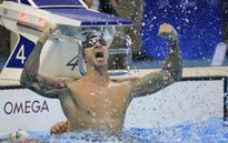 UPDATE 2-Olympics-Swimming-Ervin wins gold 16 years after his first