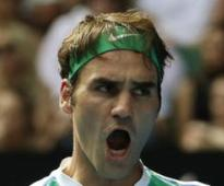 Federer apologises after Tomic jibe
