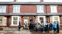 Soldiers from Duke of Lancaster's Regiment march in to help flood victims