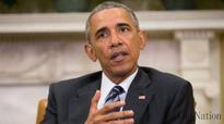 Obama sets up showdown with Congress