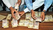 SI among 4 held for duping in name of note exchange