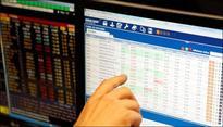 Sensex ends flat after record high; IT pares gains