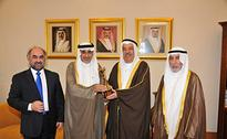 H.E Mr. Yousif bin Abdul Rahman Al Zamil Presents e-Government Excellence Award 2013 to H.E Shaikh Isa bin Ali Al Khalifa