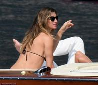 EXCLUSIVE PICTURES! Gisele Bundchen shows off her pert posterior as she sunbakes Deflategate away with husband Tom Brady in Italy