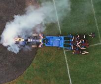 Red Bull's Latest Crazy Stunt Pits A Team Of Rugby Players Against An F1 Car