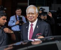 Malaysia pledges to help Swiss probe as pressu...