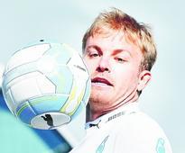 Nico pips Lewis to pole